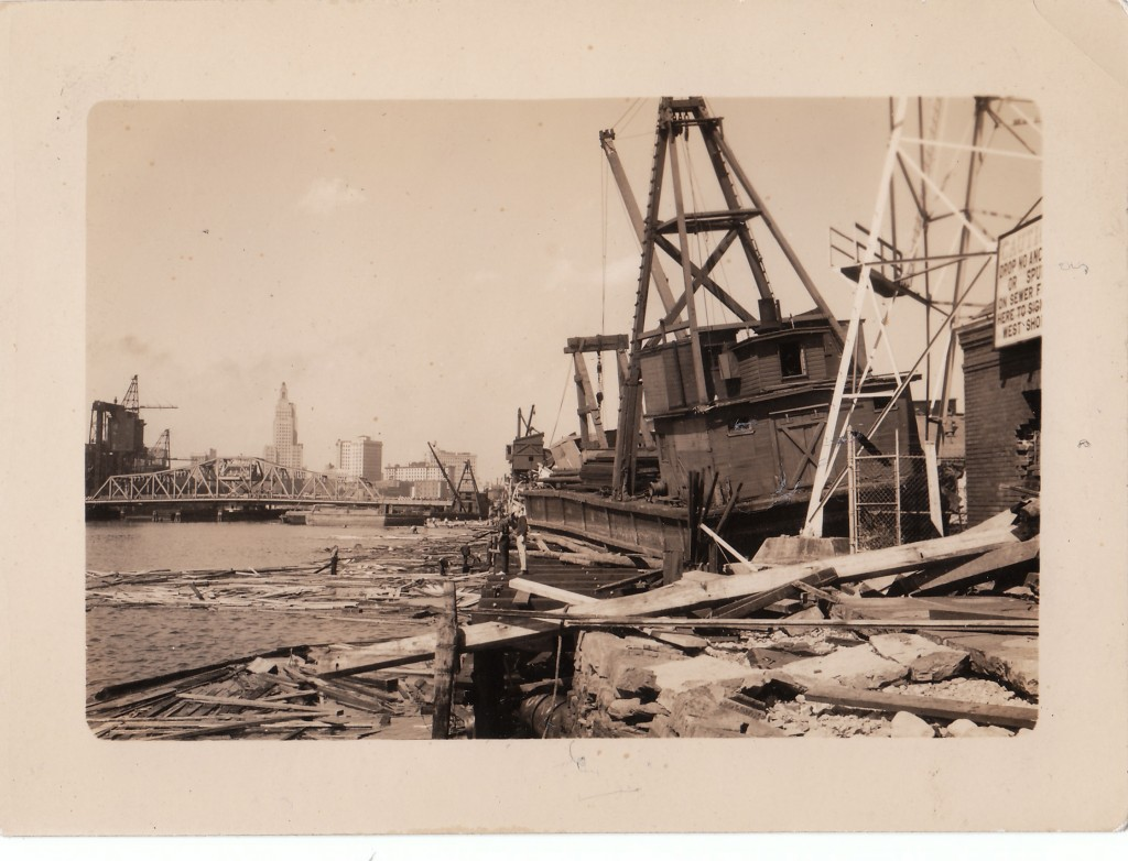 General destruction in the upper harbor, Providence, RI. Workboat floated up on land by storm surge. New England Hurricane of 1938.